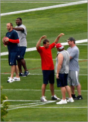 ... from where he could easily and clearly see quarterback Tom Brady (in red) gesturing to a couple of teammates while others tossed footballs.