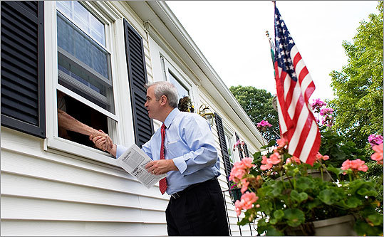 City Councilor Michael F. Flaherty Jr. greeted a voter through a window while campaigning recently with a team of volunteers in