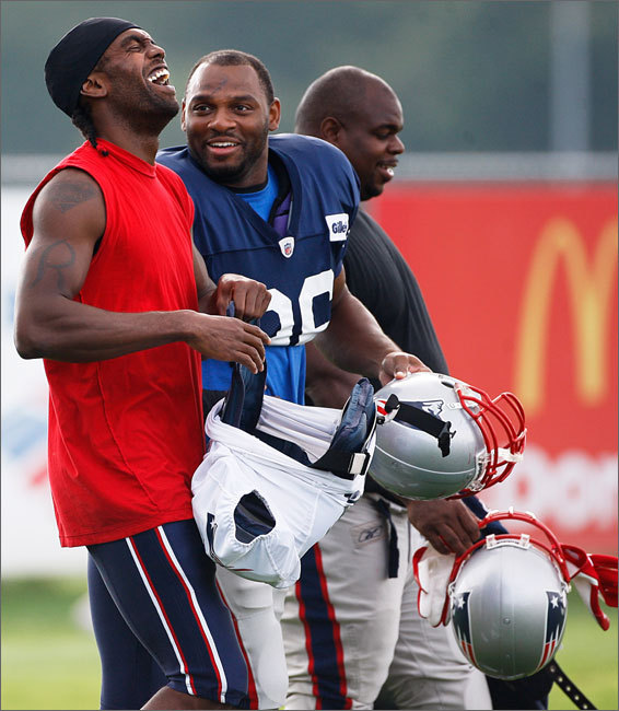 Linebacker Adalius Thomas (middle) makes Randy Moss laugh out loud along side of nose tackle Vince Wilfork (right).