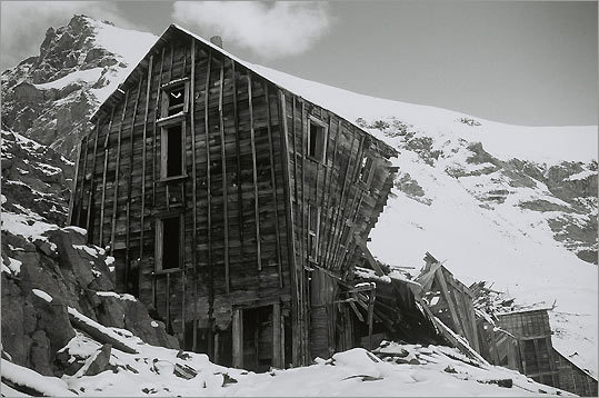 Wrangell St. Elias National Park during the fall of 2004. 'The dilapidated building is part of the Bonanza Mine complex high in the mountains near Kennicott, Alaska.'