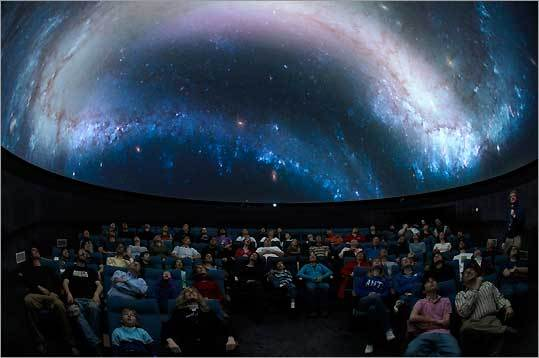 It doesn't get much colder than outer space (try minus 455 degrees Fahrenheit), but there's no need to worry about frostbite when you lounge back in the cool dark of this state-of-the-art planetarium theater at the McAuliffe-Shepard Discovery Center in Concord, N.H., to watch one of the newest shows, ''Ice Worlds.'' Explore the north and south poles of our planet without breaking a sweat, and let the images zip you away to the nether reaches of the solar system to view heavenly bodies that are truly cool, whether or not they have ice. (Think about how chilly it must be on Saturn's moon, Titan, to sail on oceans of swamp gas.) 2 Institute Drive, 603-271-7827, www.starhop.com . Adults $12, seniors and students $11, ages 3-12 $9. Planetarium shows $4 additional per person. See website for show schedule .