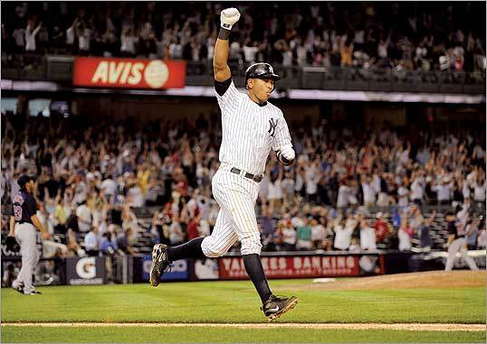 Alex Rodriguez celebrated his walk-off home run against the Red Sox in the 15th inning at Yankee Stadium on Saturday morning. The first-place Yankees won 2-0 to increase their lead in the American League East to 4 1/2 games over the Red Sox.