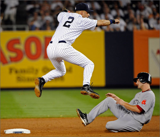Derek Jeter completes part one of a double play in the second inning as he jumps over Red Sox shortstop, Nick Green.