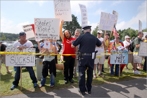 Police roped off the protesters and activists into separate groups outside Portsmouth High School.