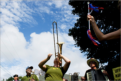 Charkey McGee, of the Leftist Marching Band, played her trombone as she arrived at the protests.