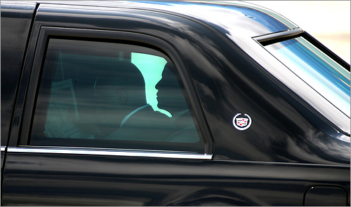 Obama, silhouetted by the tinted windows of his limousine, rides from Portsmouth International Airport at Pease to the town hall.