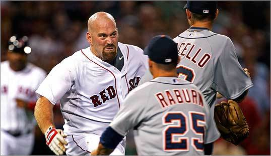 Kevin Youkilis of the Boston Red Sox tackled Detroit Tigers pitcher Rick Porcello on Tuesday night, Aug. 11, 2009, at Fenway Park. Porcello hit Youkilis with a pitch in the second inning.