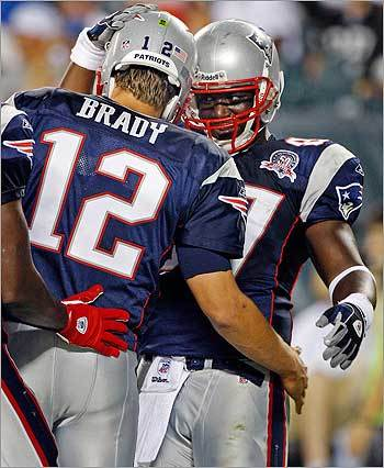 Brady celebrated after he fired a second-quarter touchdown pass to tight end Chris Baker (right).