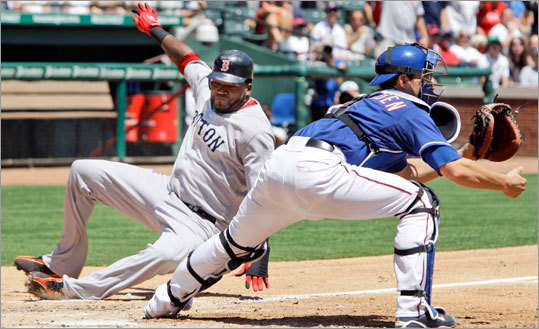David Ortiz, left, slides into home plate to score in the fifth, but it wasn't enough to lift the Sox past the Rangers.