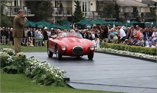 Sir Stirling Moss was driven in a 1955 OSCA MT4 he had raced at Pebble Beach in the 1950s.