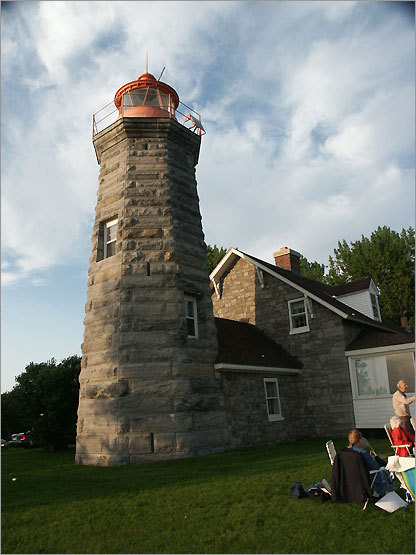 Just 2 miles south of the Canadian border, the Windmill Point Light is the northernmost of the Lake Champlain lighthouses. It remained in service until 1931, when a steel tower was erected on the property. However, in 2002, a new solar powered beacon was installed in the old tower, which remains active today. The lighthouse is privately owned and is not open to the public.