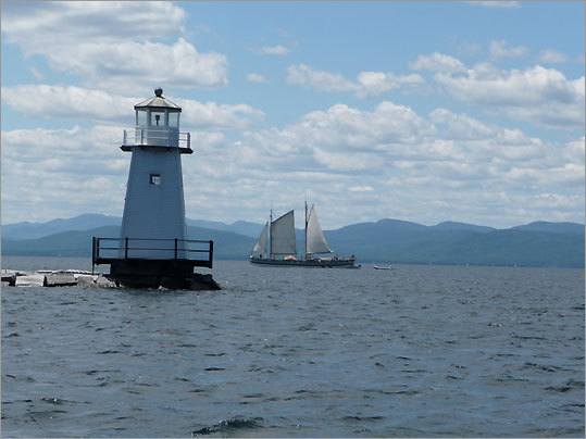 The Burlington breakwater was constructed to accommodate increased commercial traffic on Lake Champlain following the opening of the Champlain Canal in 1823. The original all-wood structures here in 1857 succumbed to ice. The lights were replaced by steel light towers: the North and Middle lights in 1925 and the South light in 1950. Today, only the North and South towers remain.