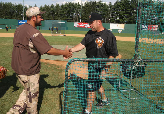 "American Defenders of New Hampshire manager Brian Daubach (left) greeted another former Red Sox player, Rich Gedman, manager of the Worcester Tornadoes, at Holman Stadium. ""He looks like he's having a lot of fun,'' says Gedman of Daubach."