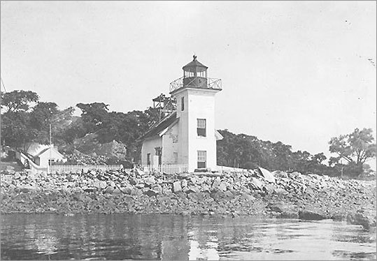 Located on Narragansett Bay, Bristol Ferry Light was built in 1855 and discontinued in 1927. Prior to the presence of the Mount Hope Bridge, which it sits below, the light helped ferry service between Bristol and Aquidneck Island. Today, the lighthouse is a private residence and is not open to the public.