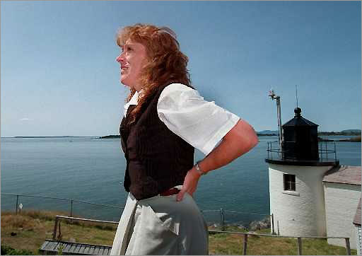 Susan Lessard, former town manager of Vinalhaven, stands outside Browns Head lighthouse, built in 1832. The ligthhouse is rented to Vinalhaven's town manager but the grounds are open to the public. The area marks a popular seaway between Vinalhaven and North Haven islands.