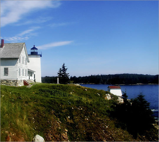 According to the Maine Office of Tourism, Burnt Coat Harbor Light, also known as Hockamock Head Light, may have earned its name either from a Revolutionary War soldier who burned his coat as a sign of rebellion or from Samuel de Champlain, who called the area 'Brule-Cote,' or Burnt Coast. Built in 1872, the lighthouse is currently under a restoration process. *Not open to the public.
