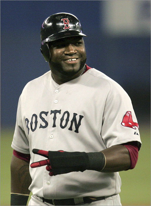 David Ortiz gestures to fans that were heckling him during the ninth inning.