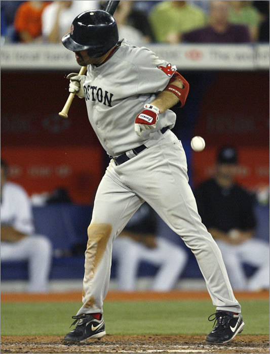 Red Sox batter Kevin Youkilis is hit by a pitch by Blue Jays reliever Brandon League during the ninth inning.