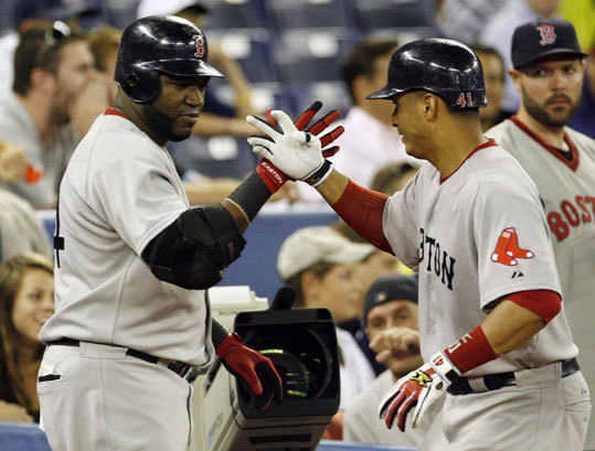 David Ortiz (left) hit a solo home run against the Blue Jays during the second inning. It was the third home run in the last three games for the Red Sox DH.
