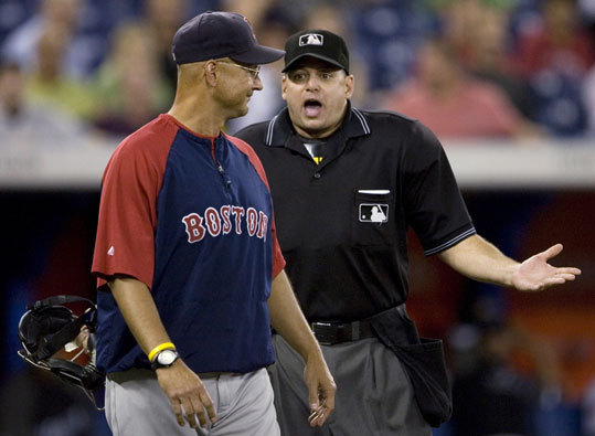 Red Sox manager Terry Francona (left) argues with home plate umpire Andy Fletcher during the ninth inning after Kevin Youkilis was hit by a pitch.