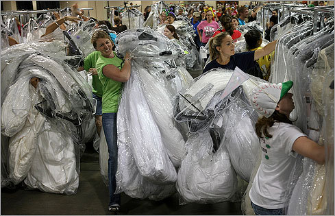 The bridezillas are unleashed. The semi-annual Filene's Basement's 'Running of the Brides' bridal gown sale is being held at the Hynes Convention Center in Boston today. Here are some scenes from this morning's chaos, and tips on how to survive the next one.