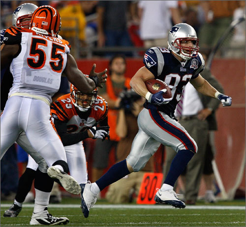 Wes Welker looks for running room after receiving a pass from Tom Brady in the first quarter. The wide receiver ended up taking this pass for a 32-yard gain in his only catch of the night.