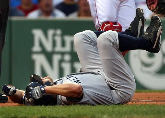 Johnny Damon fell to the ground after fouling a pitch off his foot in the first inning.