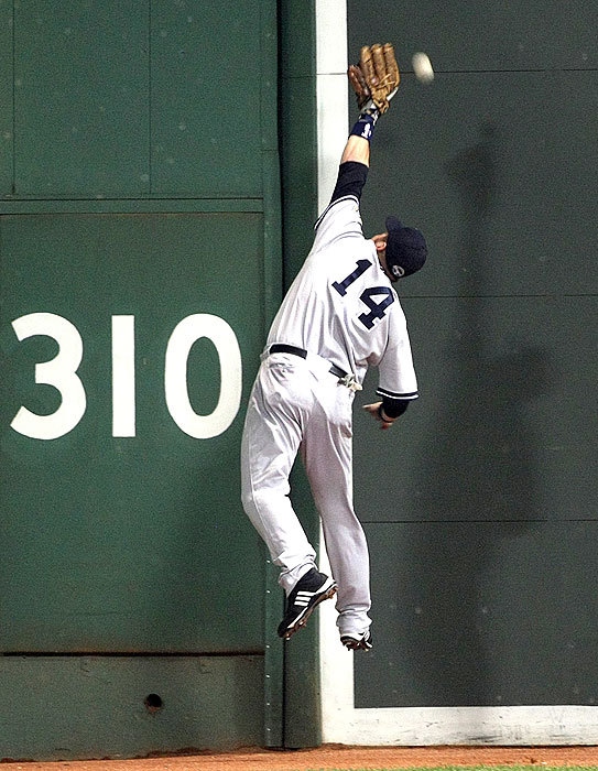 A ball hit by Dustin Pedroia bounced over the head of Yankees left fielder Eric Hinske in the fourth inning, but Hinske recovered and threw out Pedroia at third base.