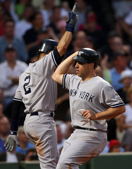 Derek Jeter and Mark Teixeira celebrated at the plate after both scored on a single by Jorge Posada in the first.