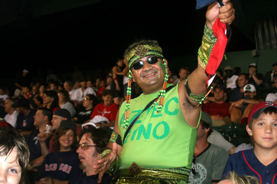 Not even 'Aztec Gino' could rally the Red Sox in the seventh inning at Fenway Park on Friday night, when Yankee fans were sent dancing in the streets of Kenmore Square after New York's 20-11 romp. 'Aztec Gino' said he came to Boston via Trinidad and Tobago and he's usually 'for the Celtics.' AG's moves didn't exactly match the immortal Gino, who dances on the Jumbotron at the Garden during Celtics victories.