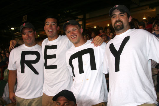 Ryan Drohan, John Porter, Jake Munroe, and Brian Brolin, all from the Roy Moore Lobster Company in Rockport, went beyond sign making in paying tribute to Jerry Remy. And the back of the shirts spelled D-A-W-G.