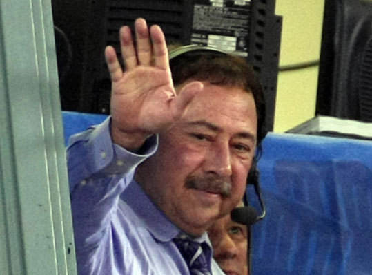 NESN broadcaster and Red Sox Nation president Jerry Remy waves to the Fenway crowd during a standing ovation for him in the third inning. It was Remy's first game back in the booth since April. Read more on Remy's return.