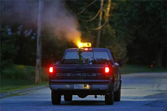 An East Middlesex mosquito truck sprays on Bedford's McIntosh Road, not far from a US wildlife refuge that bans the practice.