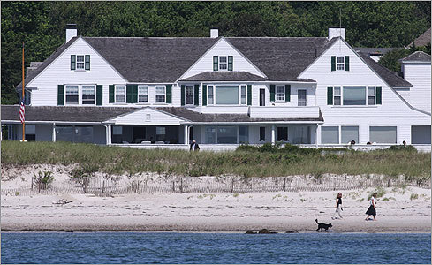 People, possibly family members, walked the beach behind the Kennedy compound around 11:25 a.m. Thursday before a private Mass was held at the house for family members.