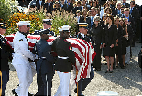 Honor guards carried Kennedy's body past his wife, Vicki, and into the JFK Library.