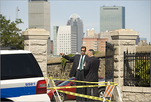 An advance team of Secret Service agents discussed security outside The Basilica of our Lady of Perpetual Help in Mission Hill, the planned site of Saturday's funeral.