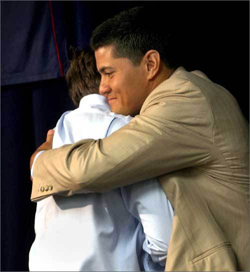 Bill Belichek and Tedy Bruschi embrace for a hug during the linebacker's retirement announcement this morning. Belichick said 'instinctiveness' and 'passion' are two words that he thinks of when he thinks of Bruschi.