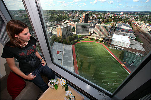 Samantha Barbosa, a senior from Grayslake, Ill., looks out from the 25th floor at the soccer field.