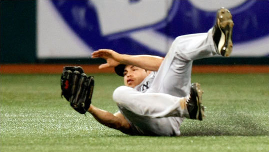 Jacoby Ellsbury makes a sliding grab in the eighth inning to help preserve the Red Sox' victory.