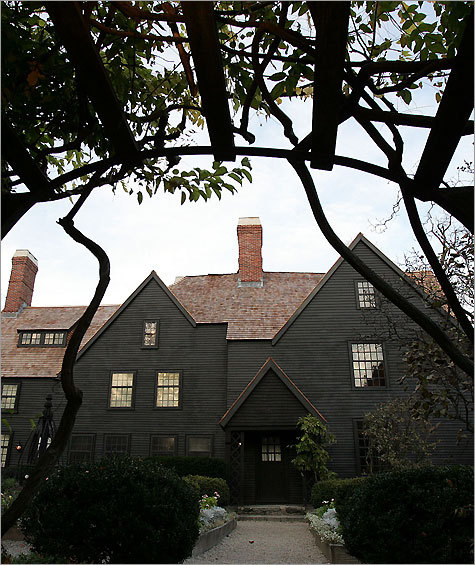 """By the time a friend and I arrived at Salem's Washington Square, the image of this historic village I had conjured up as a child had been destroyed. I love old things, but here, modernity – cars everywhere, restaurants flaunting international cuisines, tourists buying plastic witch souvenirs by the dozen – intruded everywhere. A tour of the Salem Witch Museum, where mannequins lining the walls of a dark room light up to """"tell"""" a dramatic tale of the witch hysteria, left us disappointed. But the famed House of Seven Gables, the site of Nathaniel Hawthorne's novel by the same name, put us in a better mood. Overlooking the harbor, the house offered history in small, consumable doses. The highlight was going up one of the narrowest secret staircases in the world in the oldest part of the house. A piece of its 17th century front door is preserved in a glass case, so I had to be content with running my fingers over its shinier modern counterpart. Nandini Jayakrishna"""