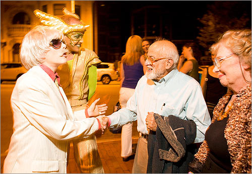 Max and Hilda Perlitsh shook hands with cast members, from left, Mr. Oberon and Dr. Wheelgood.