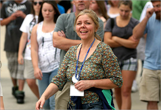 Elizabeth Alexander, 51, from Plymouth, leads a group of incoming students around Cape Cod Community College's campus during student orientation in West Barnstable. Alexander is returning for her third semester after working in sales and marketing.