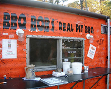 "BBQ Bob's ""Real Pit'' BBQ When Bob Ballou played in a blues band back in the day, a band mate nicknamed him ""BBQ Bob'' after the legendary Georgia country blues singer. The name stuck, even if Ballou gave up music after 13 years because ""with kids to take care of, it didn't exactly pay the bills.'' A bigger than life character, he's been a pit master ever since, setting up in an orange trailer next to The Good Food Store nearly four years ago. Ballou keeps it simple: chicken, pulled pork, whole slabs of pork ribs, and a brisket rubbed with mustard seed, garlic, ground chili peppers, and just a little salt. ""I cook it overnight for around 16 hours so it's black and ugly on the outside and tender and juicy inside,'' he explains. ""One of my customers from Oklahoma came up with the slogan, 'You don't need teeth to eat our beef.' Some of my older regulars will back that up.'' 212 Mayville Road (Route 2), Bethel, Maine. 207-824-4744, www.therealbbqbob.com . Open Thursday-Tuesday for lunch and dinner. $6.99-$22.99."