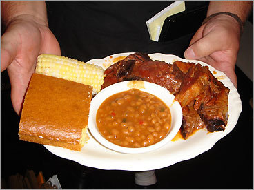 Contrary to myth, you need neither a bluetick hound nor a pickup truck to enjoy eating Southern barbecue. Nor need you drive down an unnamed road in rural Mississippi to find it. Thanks to tireless proselytizing by the New England Barbecue Society and the presence of some talented pit masters in our midst, the land of the bean and the cod is now dotted with great joints serving meat cooked ever so slowly by the indirect heat of a smoky wood or charcoal fire. Greater Boston is blessed with a number of superb barbecue venues, but you won't have to forsake a heap of pulled pork or a plate of burnt ends when you light out for the territory. Here's a guide to 10 of New England's smokiest grills. Patricia Harris & David Lyon can be reached at harris.lyon@ verizon.net.
