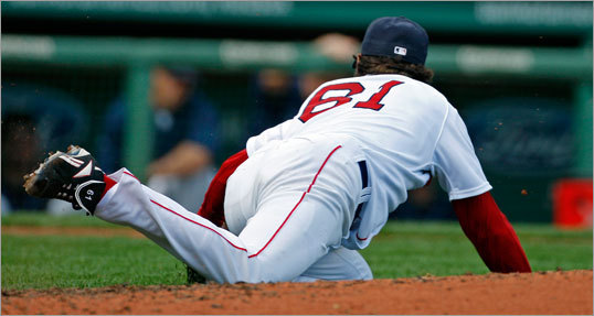 In Game 1, Red Sox pitcher Clay Buchholz hit the grass as he bounded off the mound and fielded a third-inning, two-out grounder off the bat of Tampa Bay's Jason Bartlett, then got up and made a nice off balance throw to first baseman Casey Kotchman to retire the side. (continued)