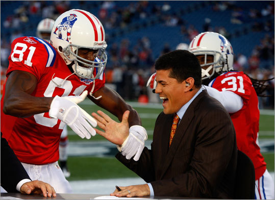New ESPN broadcaster Tedy Bruschi gets a warm welcome from former teammates Randy Moss (left) and Brandon Meriweather.