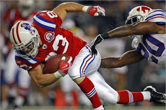 Patriots wide receiver Wes Welker eludes the grasp of Bills safety Donte Whitner, grabbing a short pass and getting to the 1-yard line to set up the Patriots' first touchdown.
