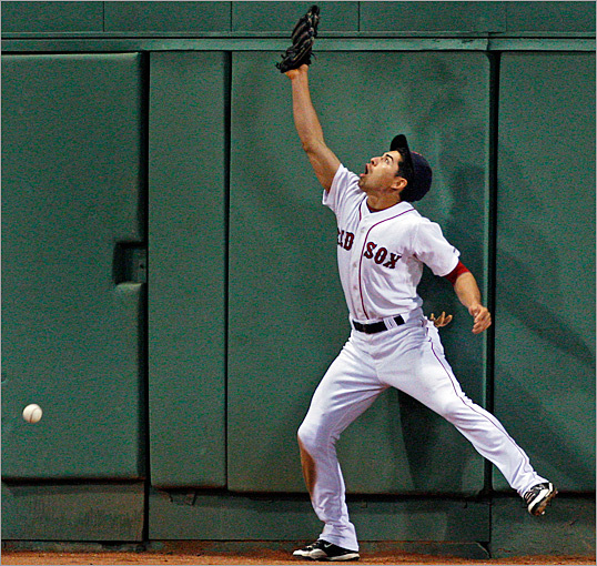 Jacoby Ellsbury missed the ball after leaping for the two-run double by Juan Rivera in the top of the seventh inning.