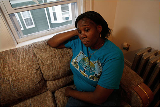 Lucine Williams was one of the workers who recently lost her job at the Hyatt Regency Boston, shown here in her Dorchester home. 'I don't know how they can treat people like that,' said Williams,