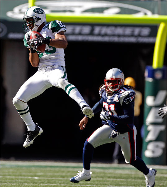 Jets wide reciever Chansi Stuckey made a leaping catch over Patriots safety Brandon Meriweather (31) in the third quarter that gave the Jets a first and ten on the Patriots 37-yard-line.